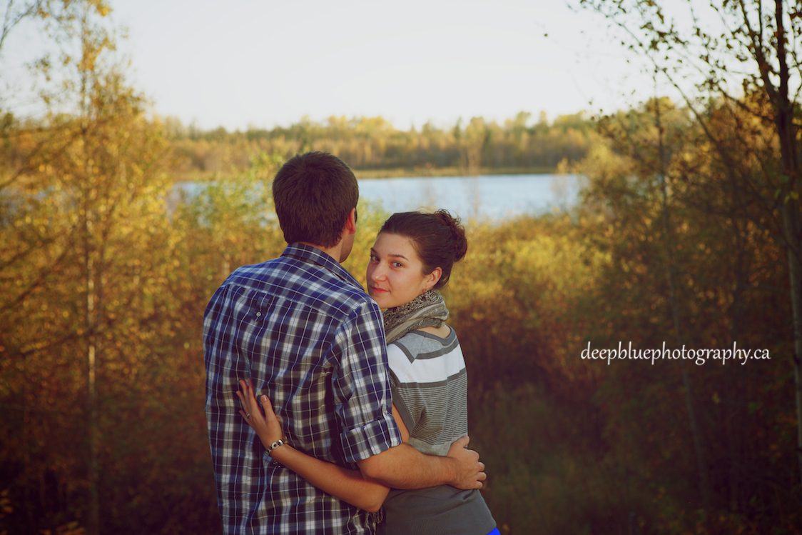 Portrait of Couple standing by a lake