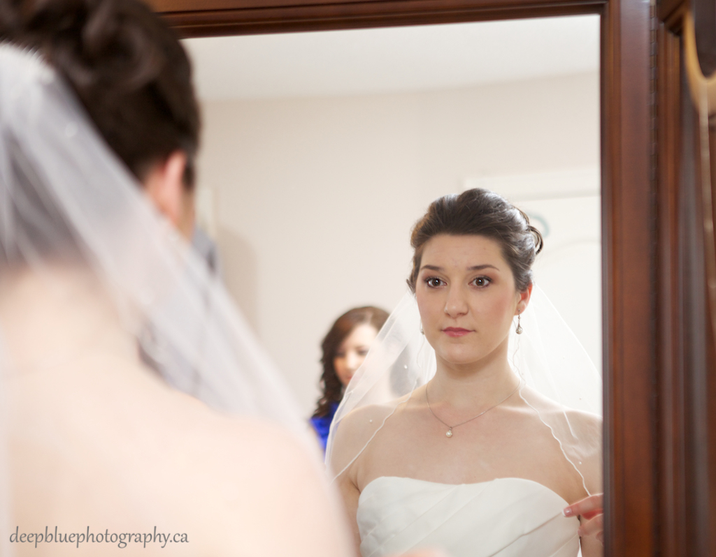 Natalie Checking her Veil in the Mirror