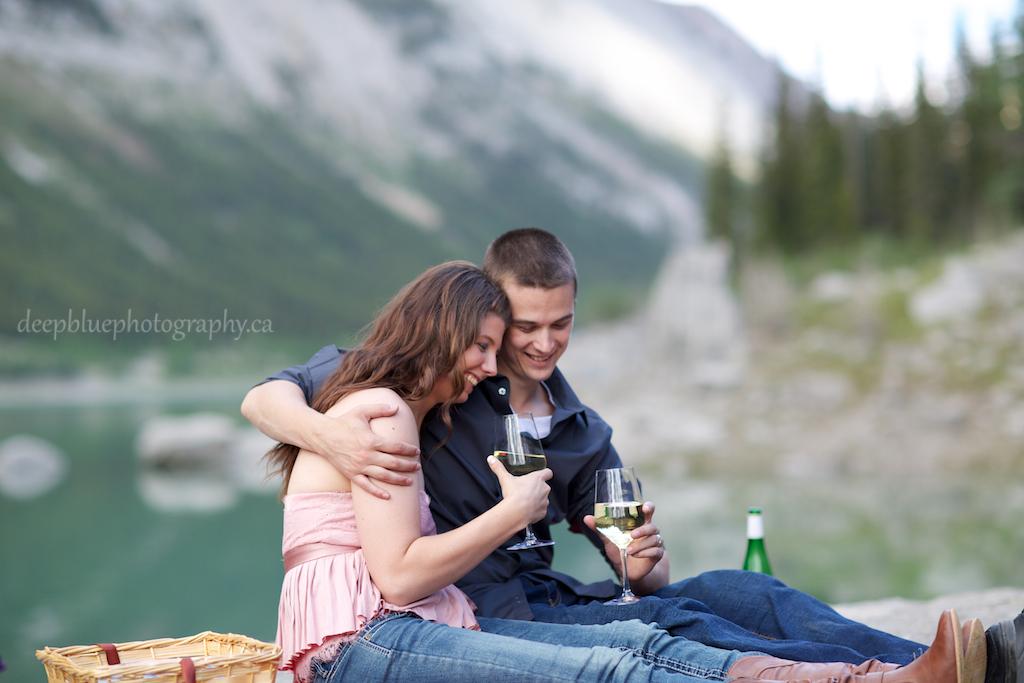 Photo of Couple Sharing Mountain Picnic