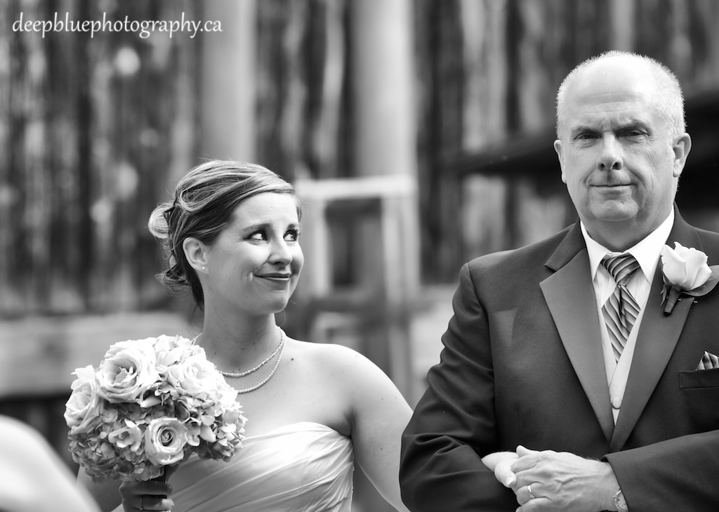 Photo of Rachel Walking Down the Aisle with Her Father During Her Clerks Quarters Wedding In Edmonton