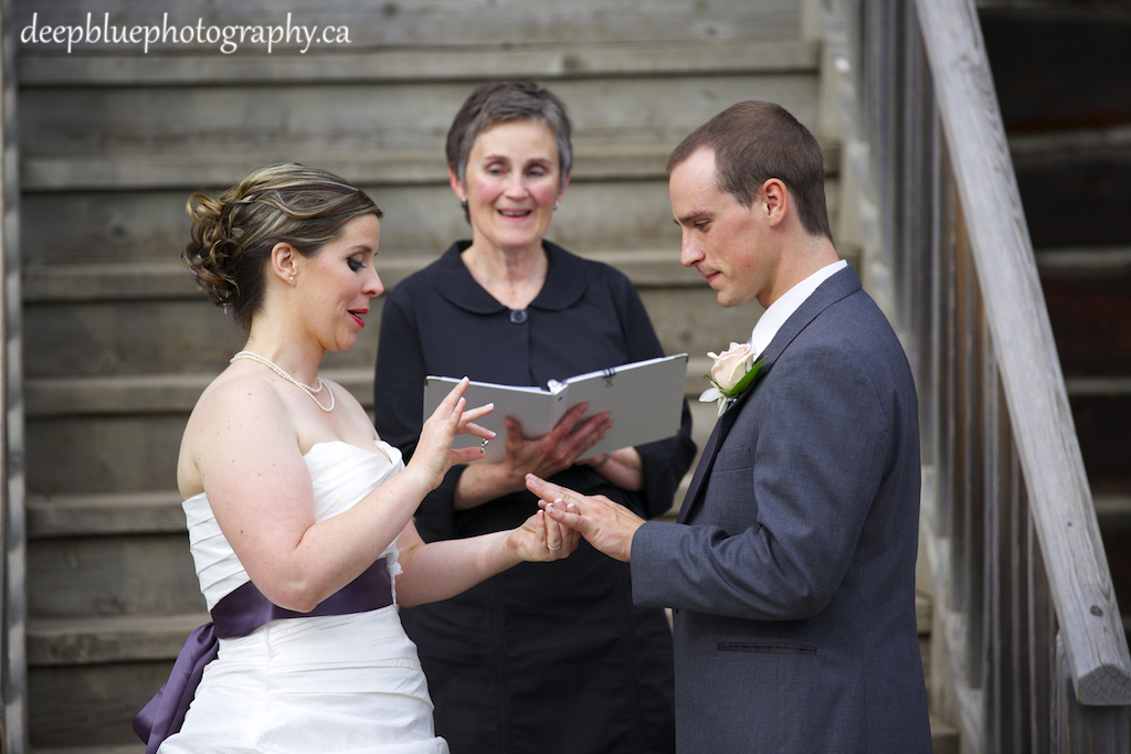 Cute Photo of Bride Putting Grooms Ring On