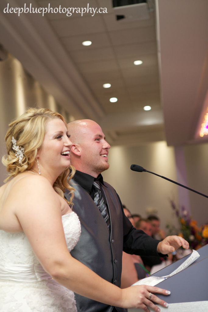 Photo of Bride and Groom Giving Speech At Their Chateau Louis Hotel Wedding