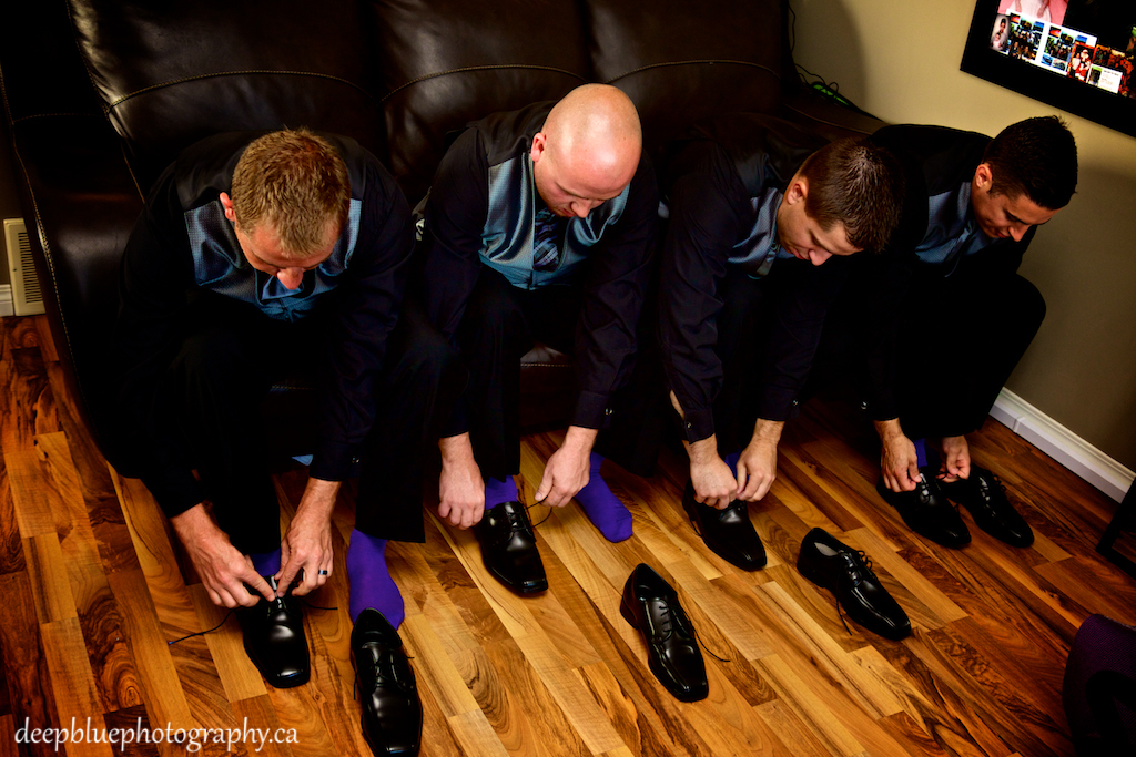 Groomsmen with Purple Socks Getting Ready