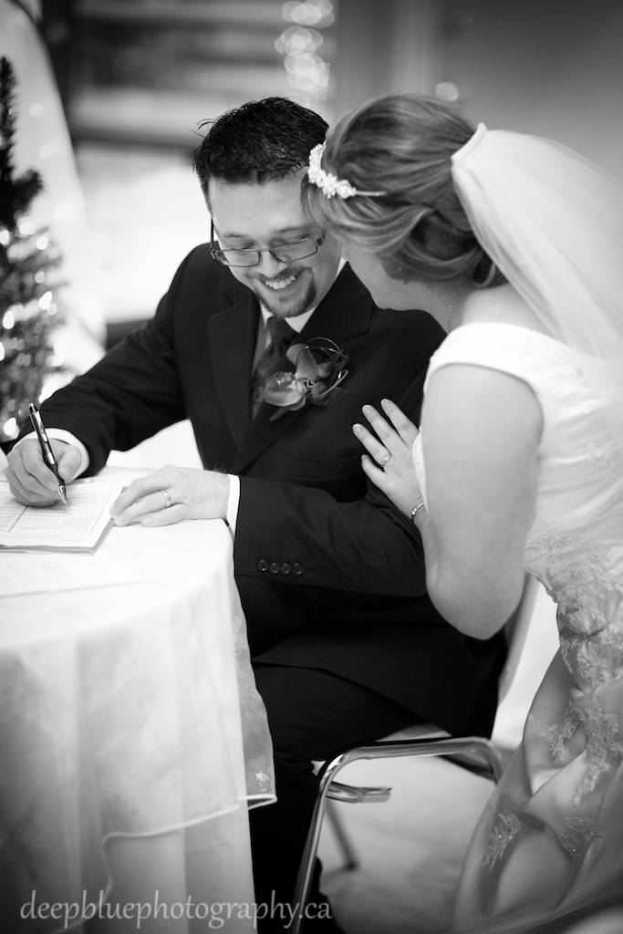Pam and Jay signing the register