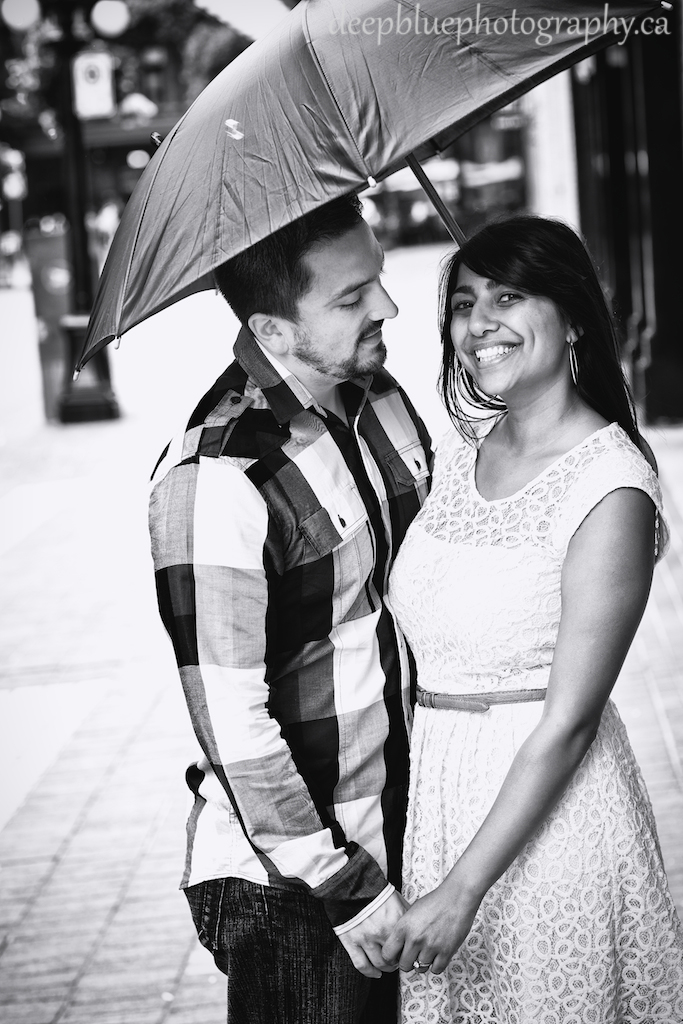 Engagement Photo of Couple Under Umbrella