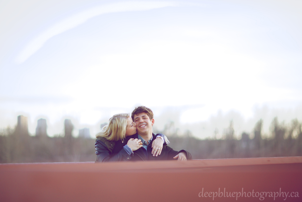 Photo of Megan Kissing John on the Bridge - Louise McKinney Park Engagement Photography