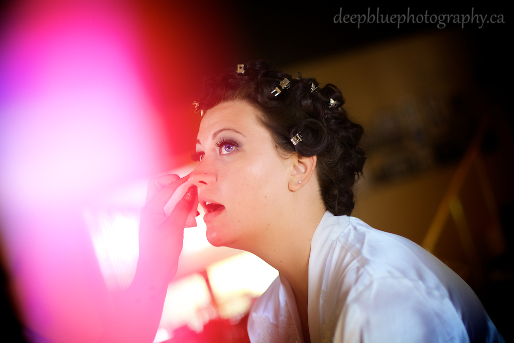 Photo of bride getting her makeup done