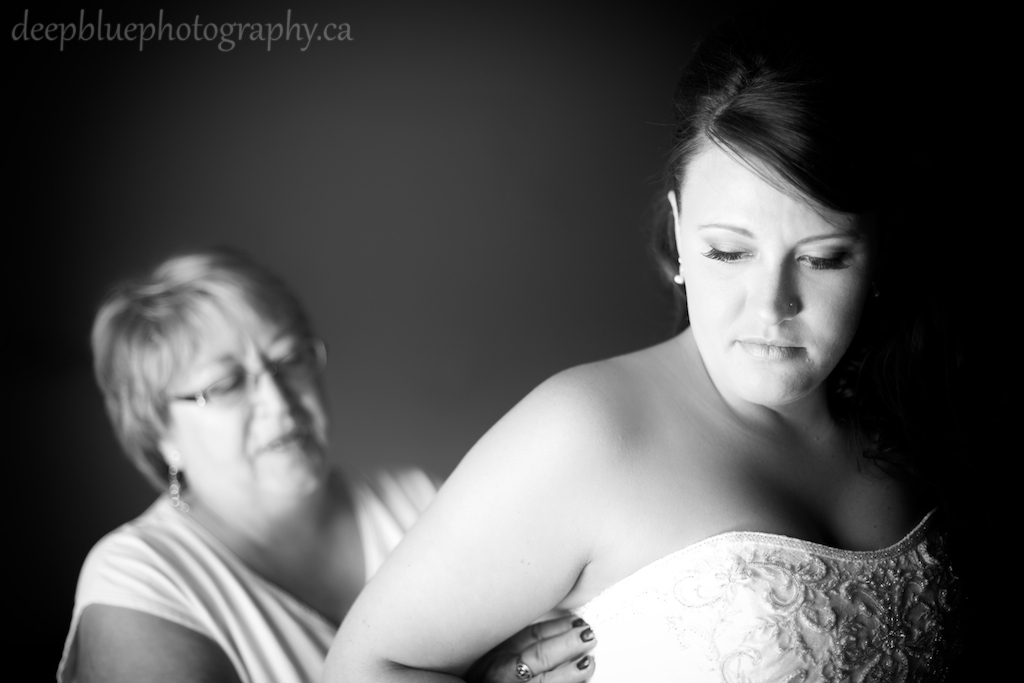 Photo of the bride getting her dress on