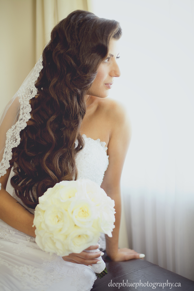 Photo of bride sitting by window waiting for the groom - Lebanese Wedding Photography