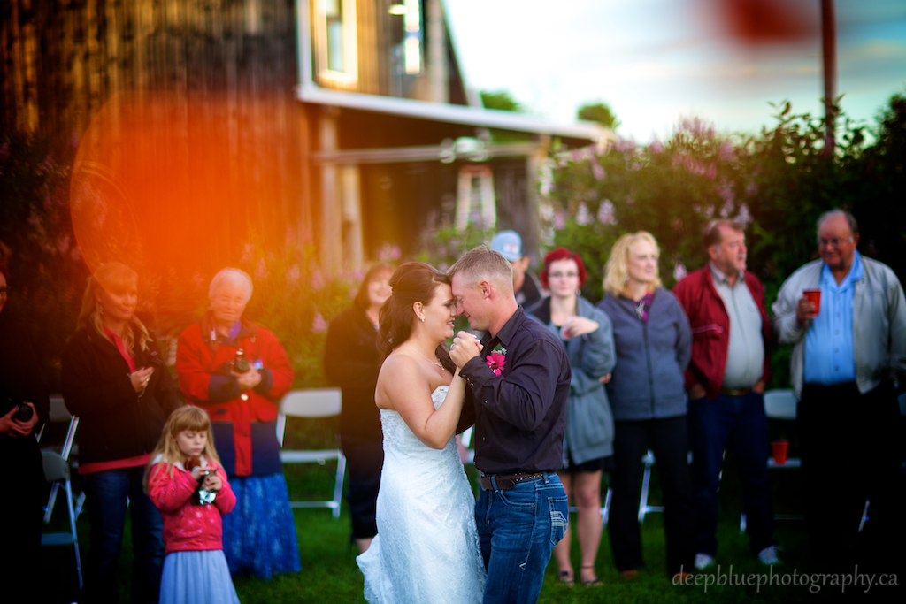 Bride and Groom share first dance under the summer sky