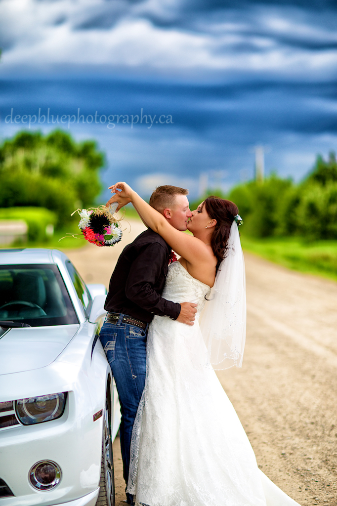 Bride and Groom with Camaro car