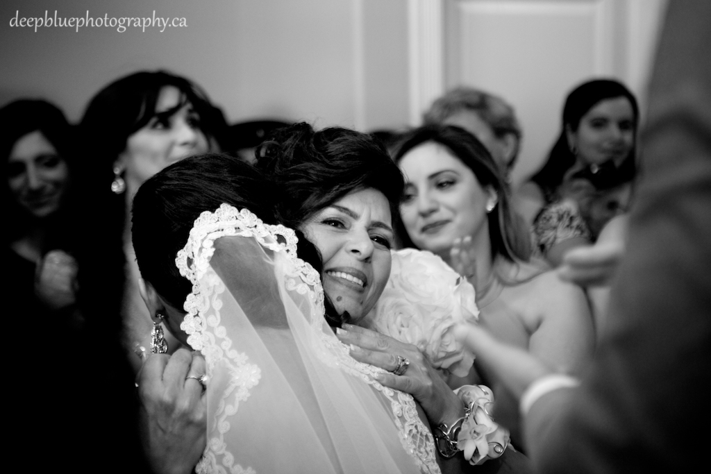 Photo of the bride hugging her mother