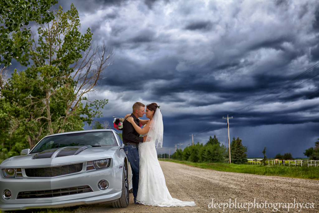 Bride and Groom country wedding portrait with Camaro