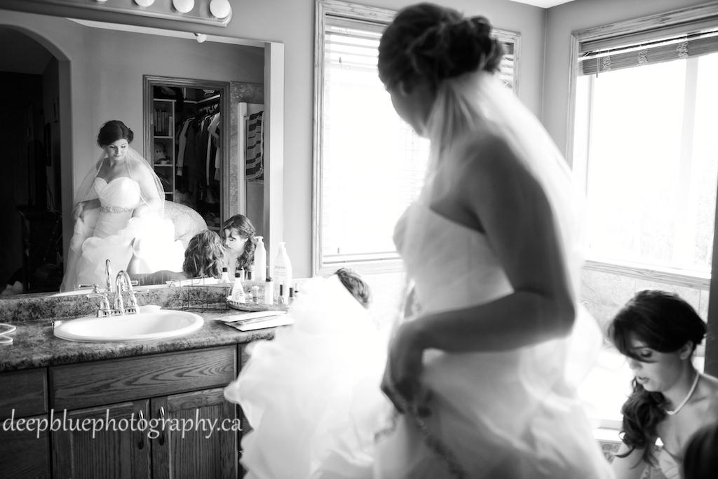 Bridesmaids help Alannah into her dress