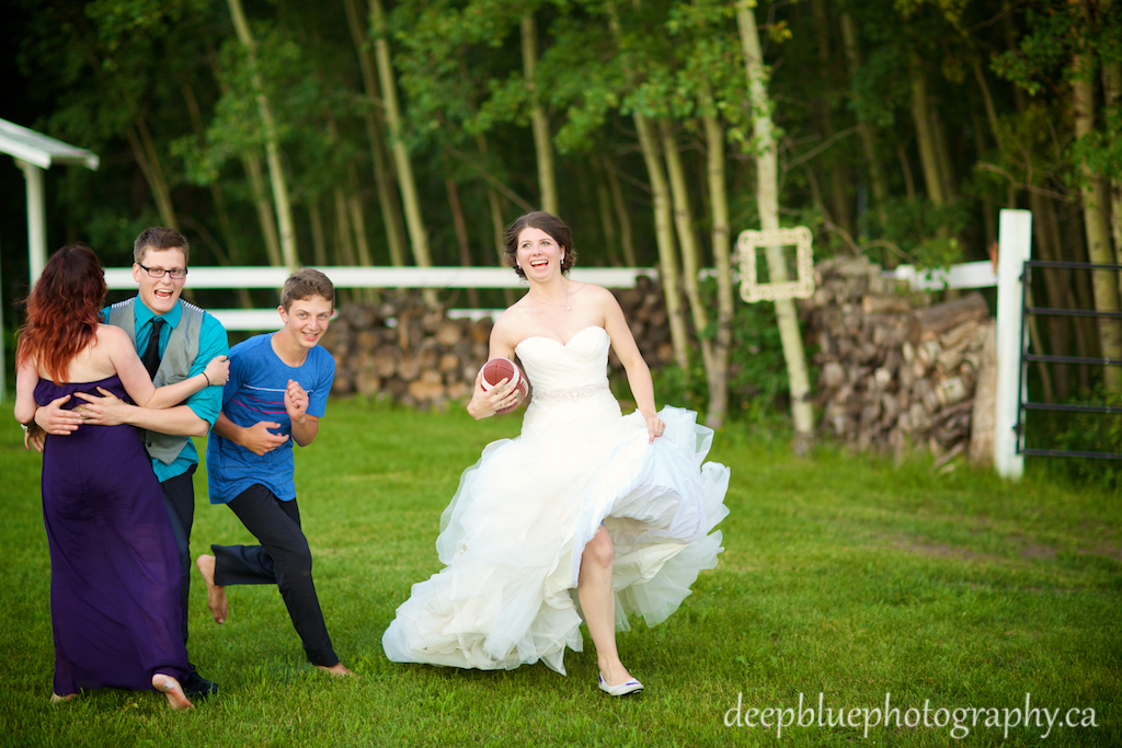 Alannah playing football in her wedding dress