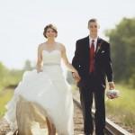 Alannah and Roland walk down train tracks
