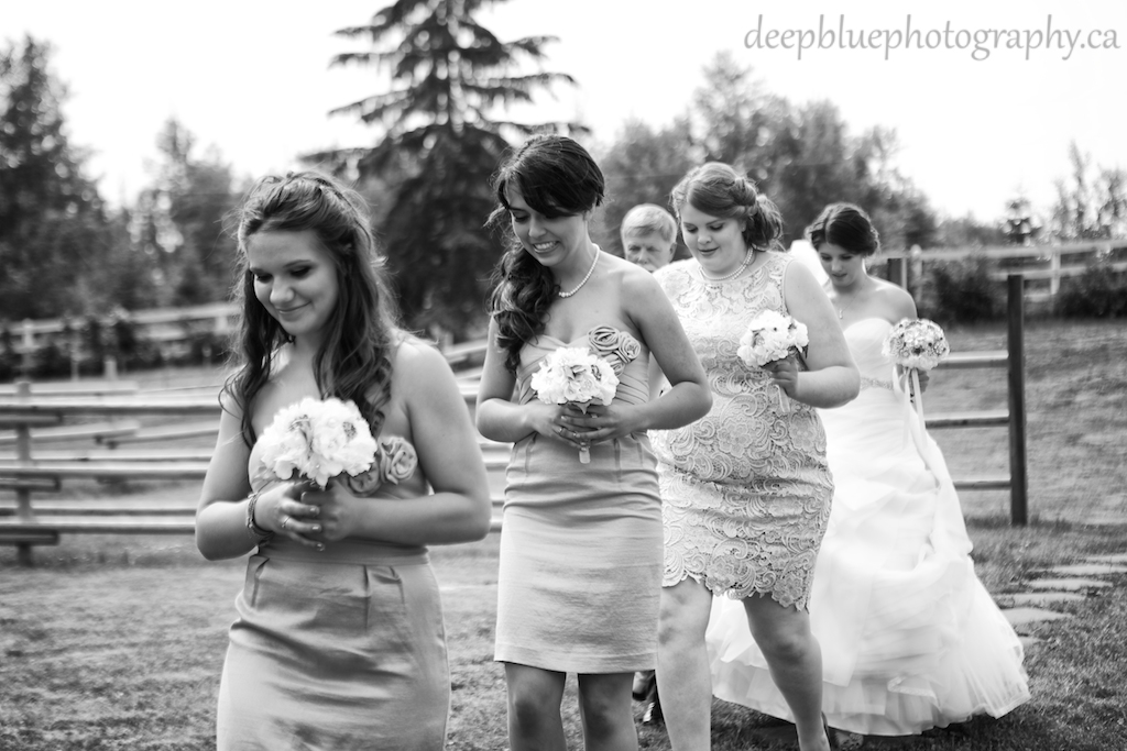 Alannah and her bridesmaids walking in
