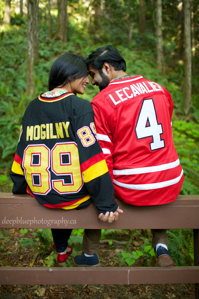 Monica and Aaron in their hockey jerseys