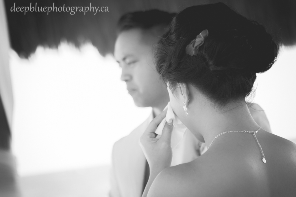 Bride sheds a tear during destination wedding ceremony