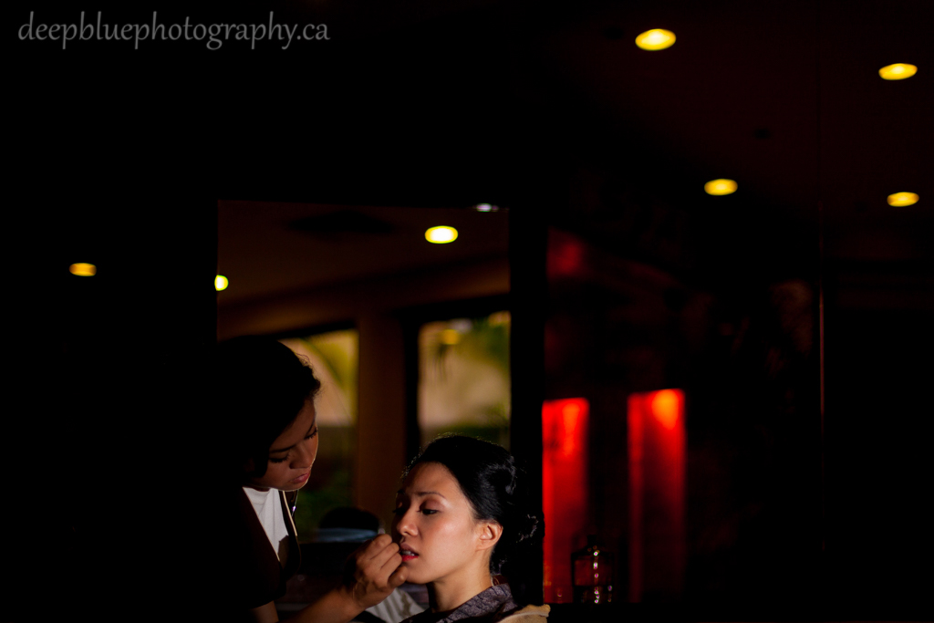 Photo of bride getting makeup done