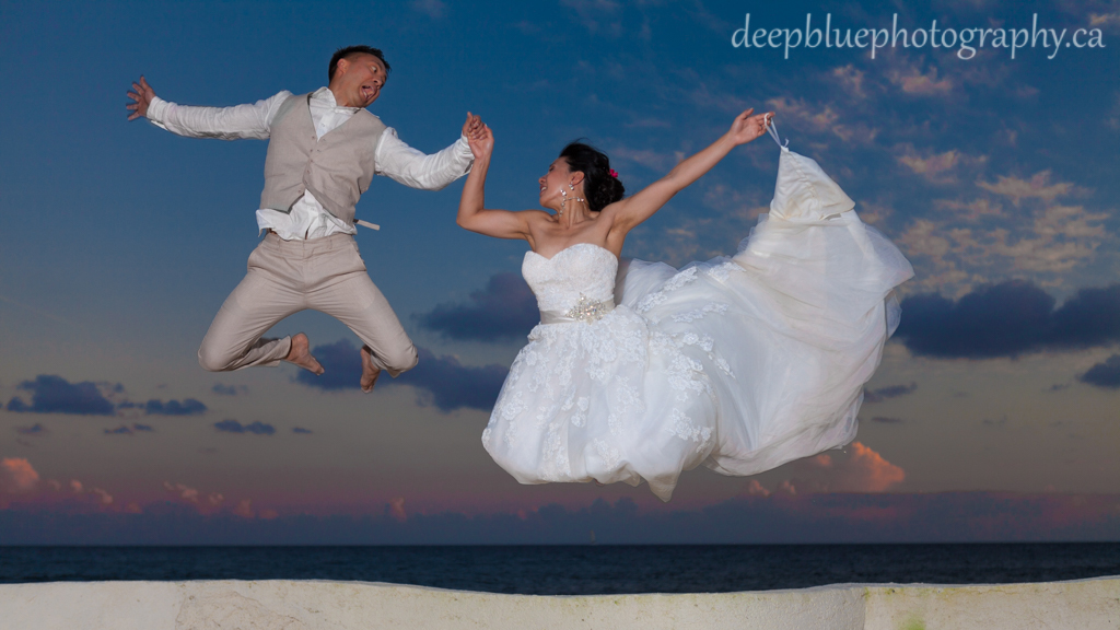 Bride and Groom beach jumping photo