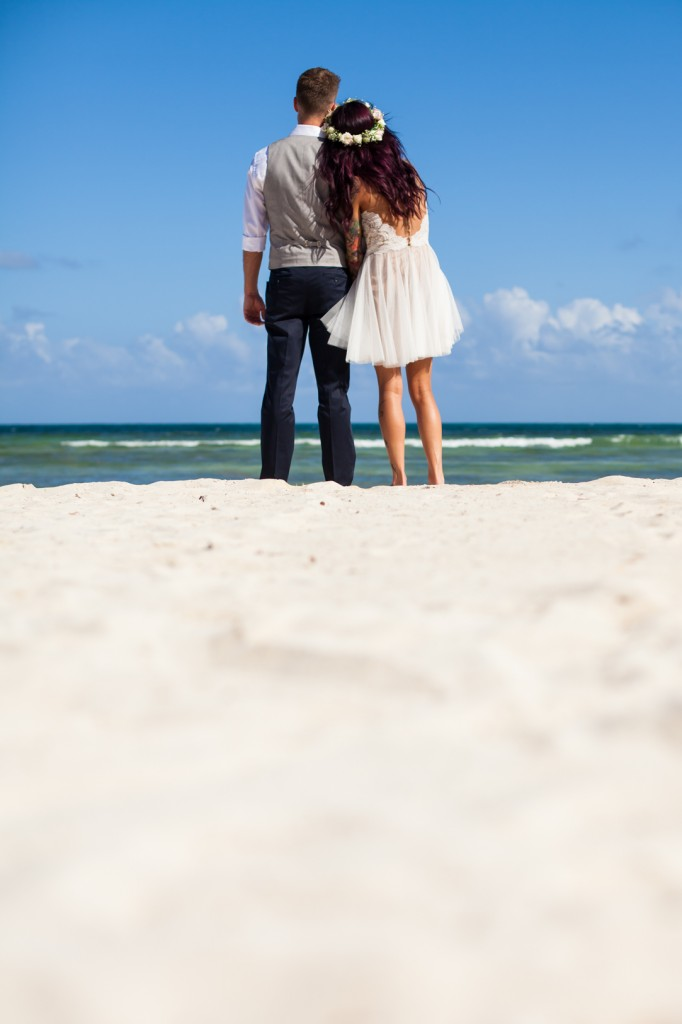 Bride and Groom Standing on Sand