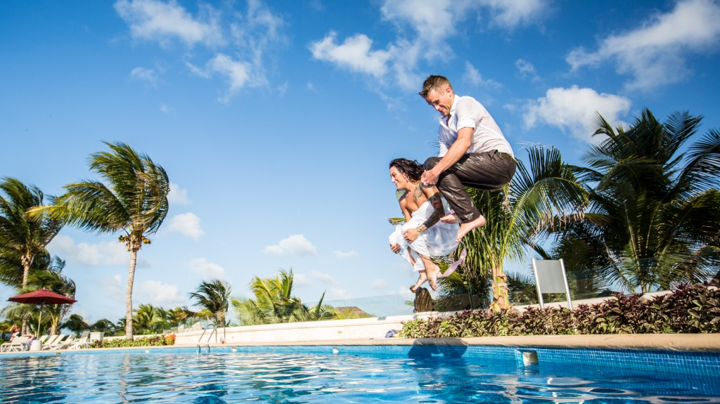 Wedding Couple Jump into Pool - How to Plan a Destination Wedding