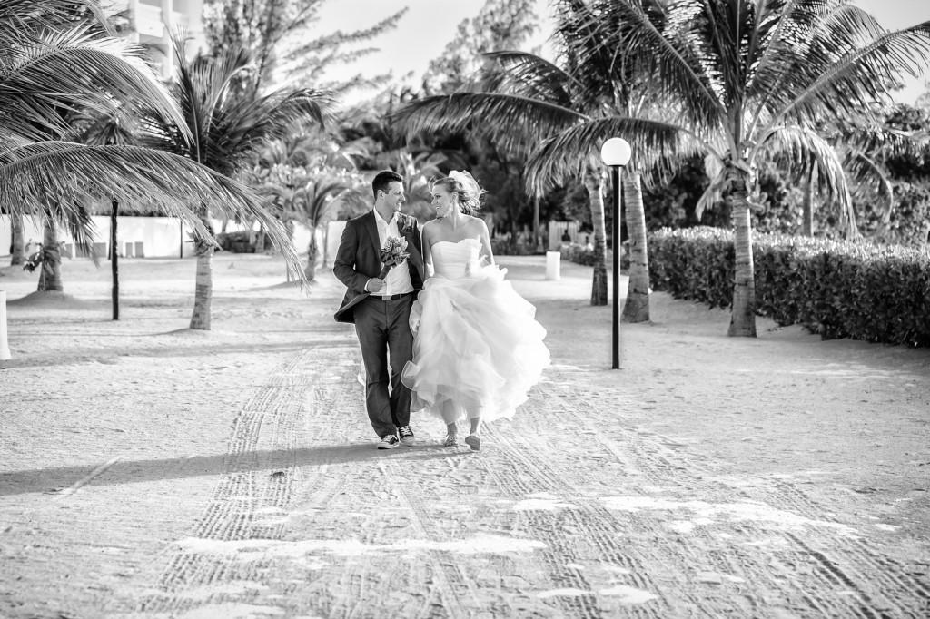 Bride and Groom Walking down Beach