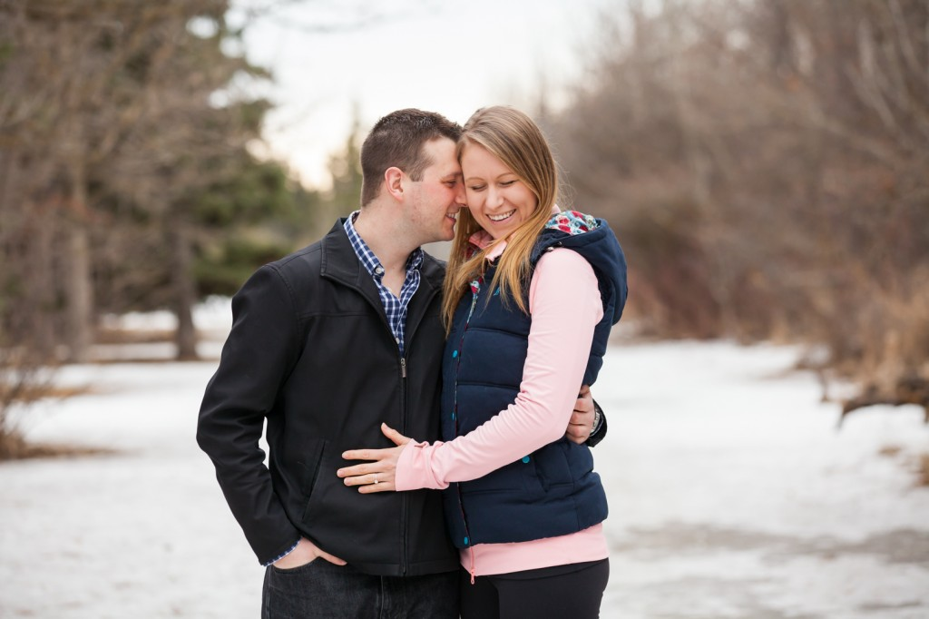 A Photo of a couple snuggling in the snow - Preparing for Engagement Photos