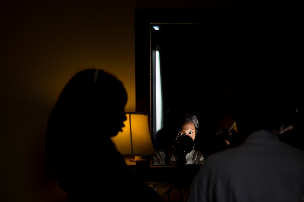 Photo of Bride Putting on Makeup - Fairmont Banff Springs Wedding