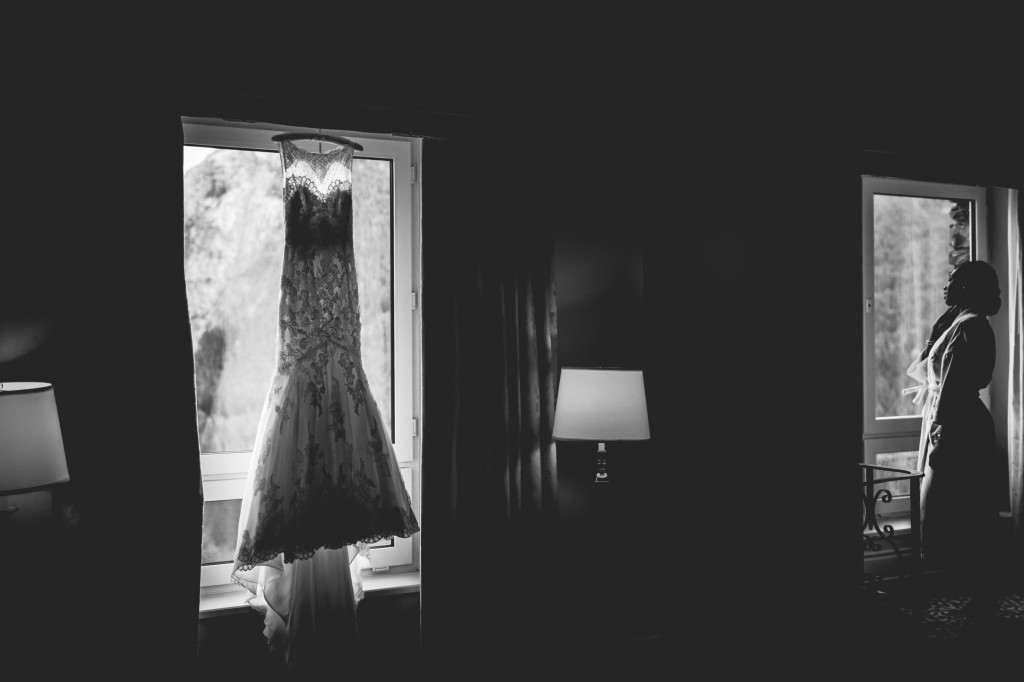 Photo of Bride with Dress Hanging Fairmont Banff Springs