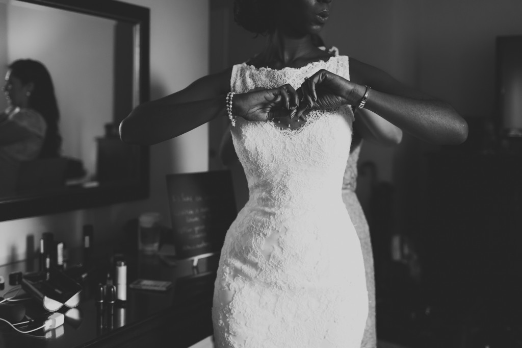Photo of Bride Getting Dress On