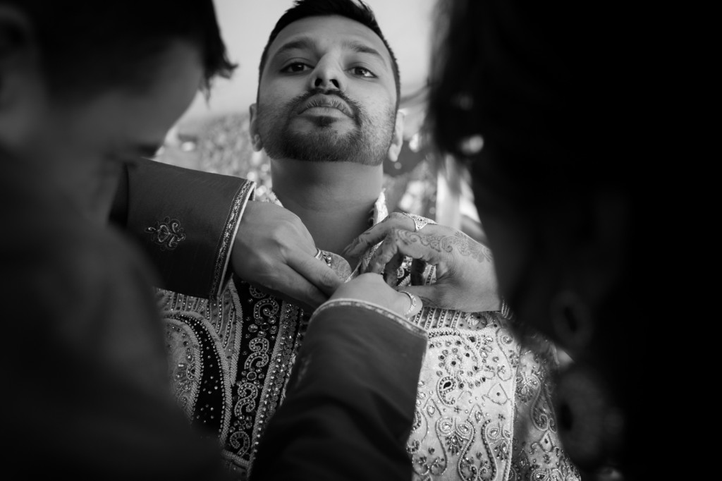 Groom Getting Ready To Show The Importance Of Light on Your Wedding Day