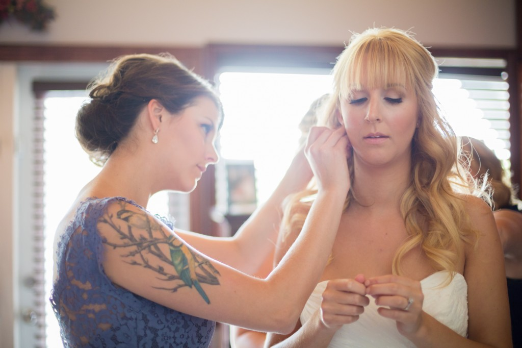 Picture Showing Bride Getting Help Getting Ready To Show Why Light on Your Wedding Day Is Important