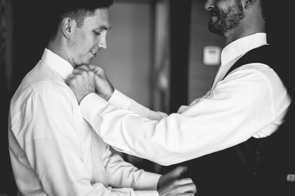 Photo of Groom Getting Dressed
