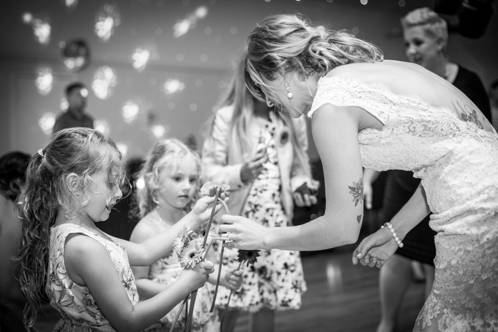Bride Handing Out Flowers