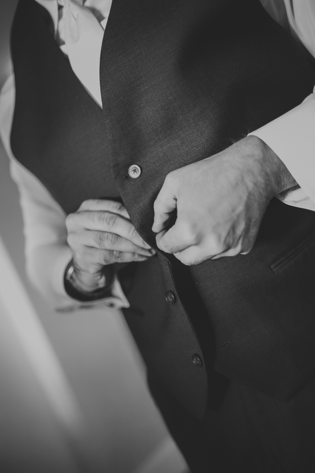 Groom Putting on Suit