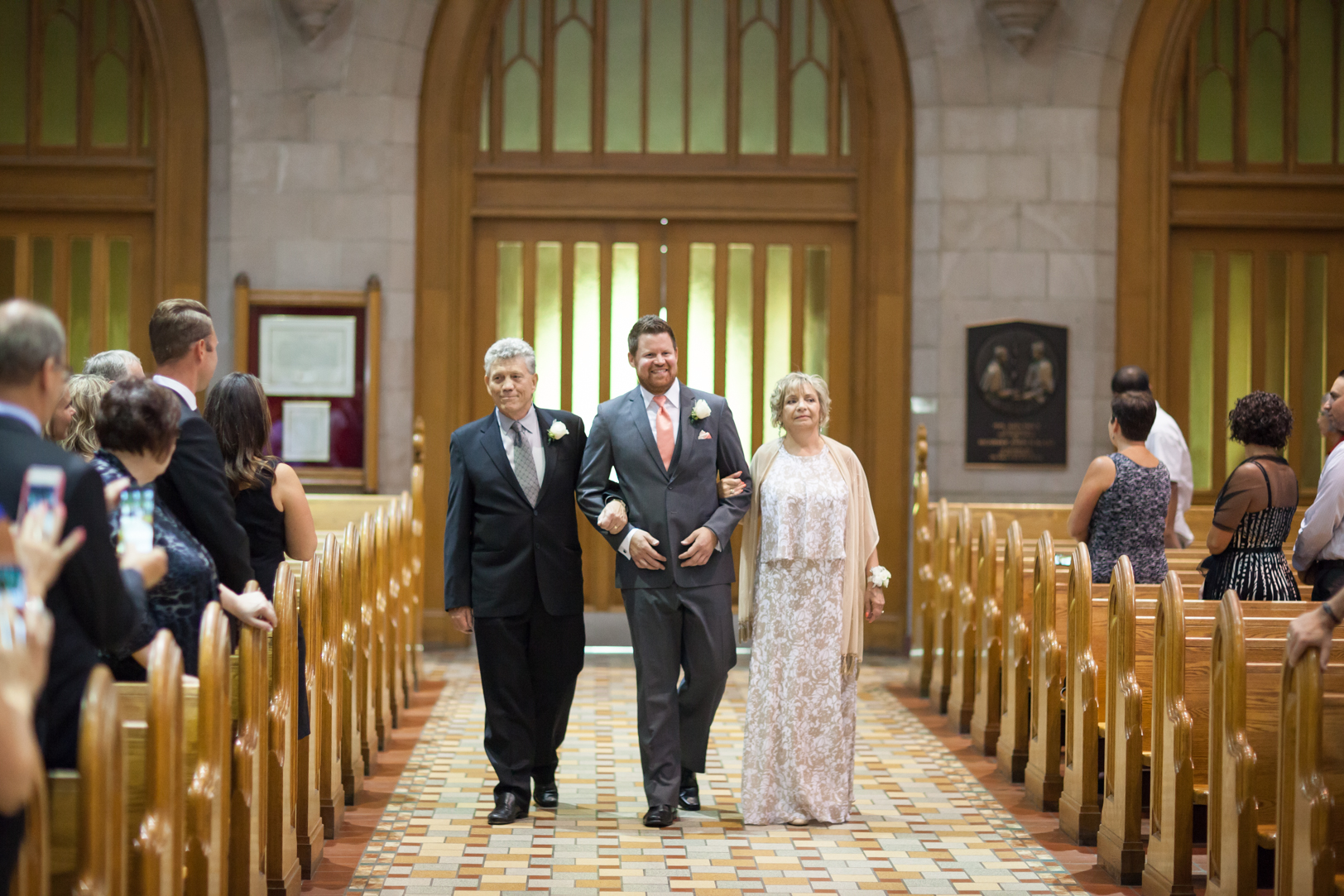 Groom Walking with parents at his St Joseph Basilica Wedding