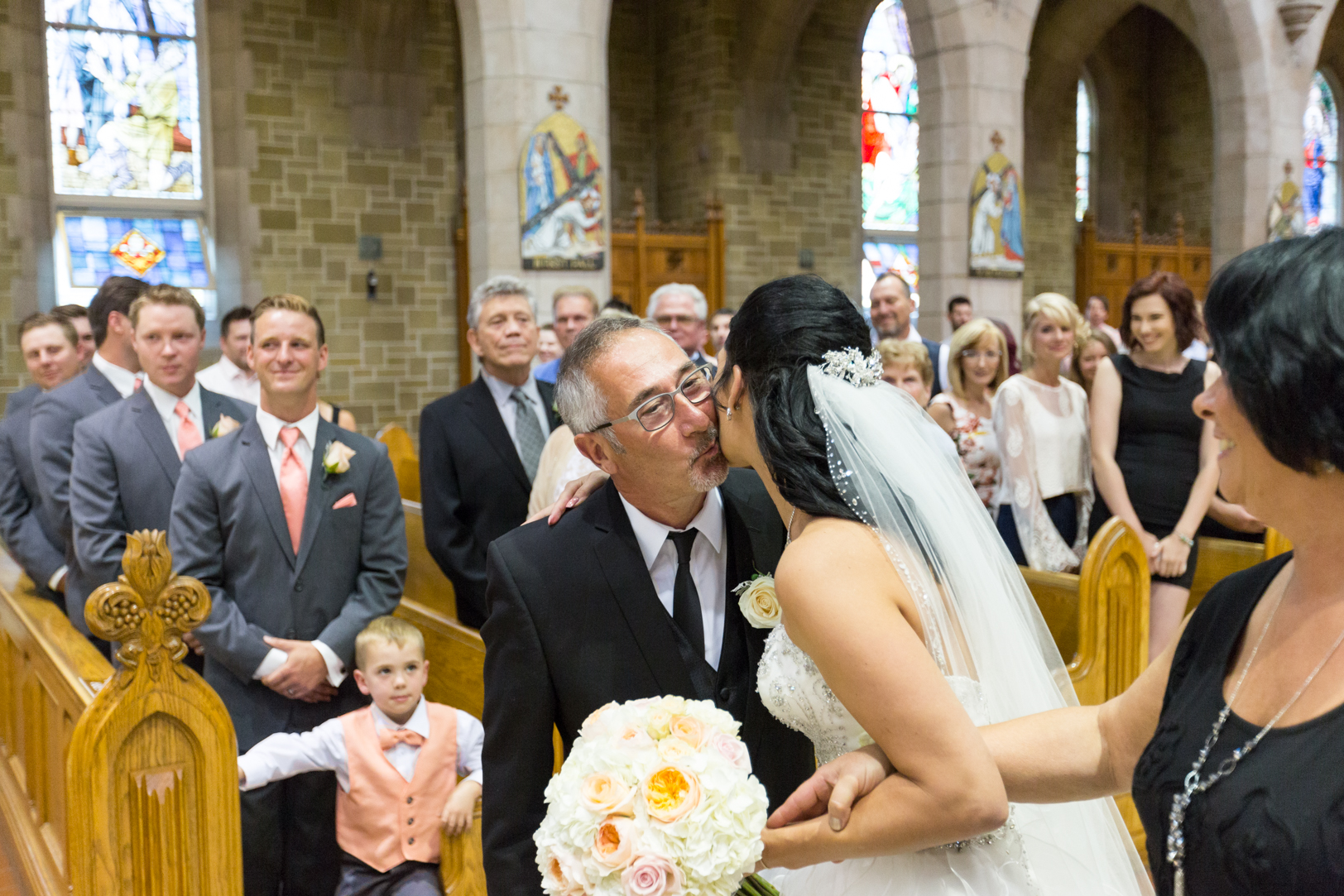 Father giving away bride at St Joseph Basilica Wedding