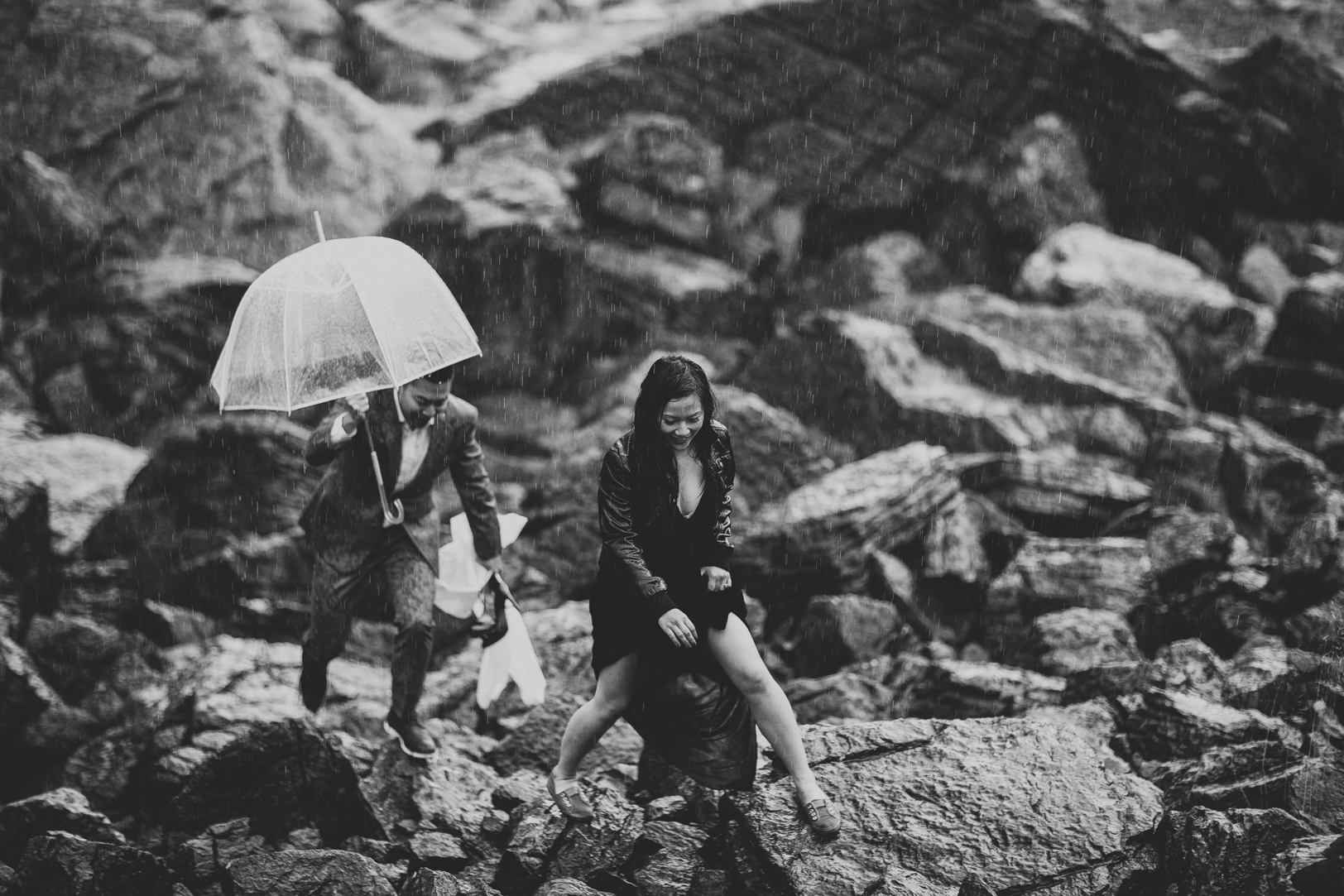 Engagement Photos with Umbrella - engagement pictures in the rain in Jasper