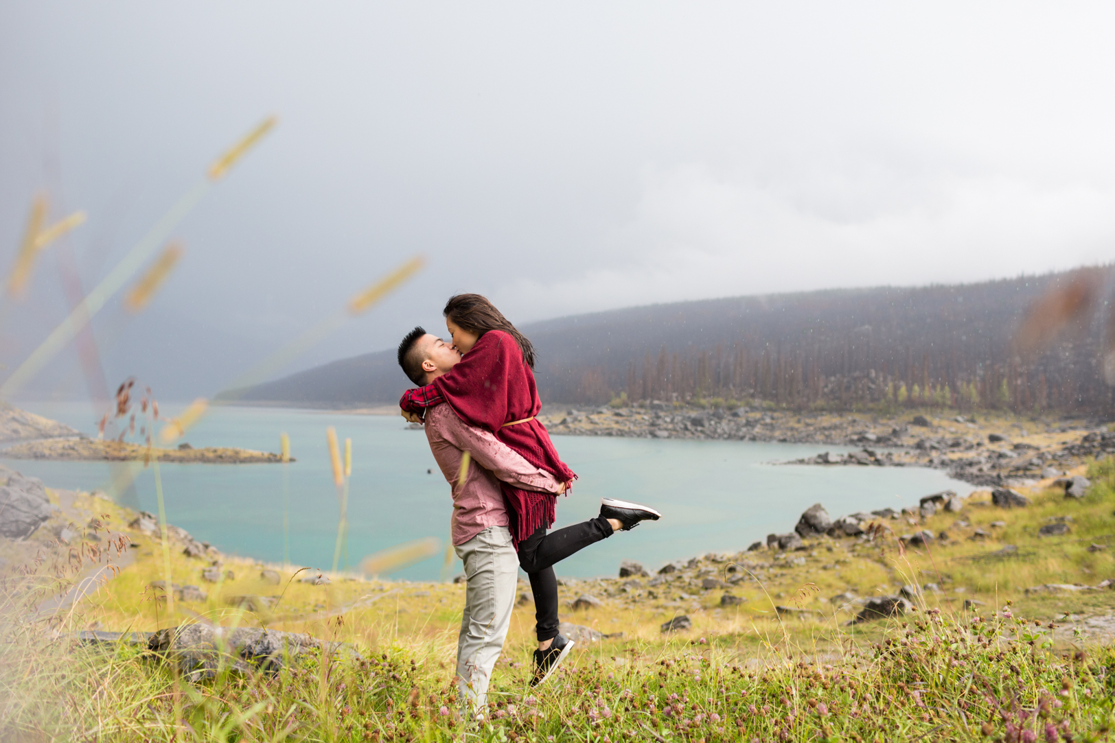 creative jasper engagement picture near lake