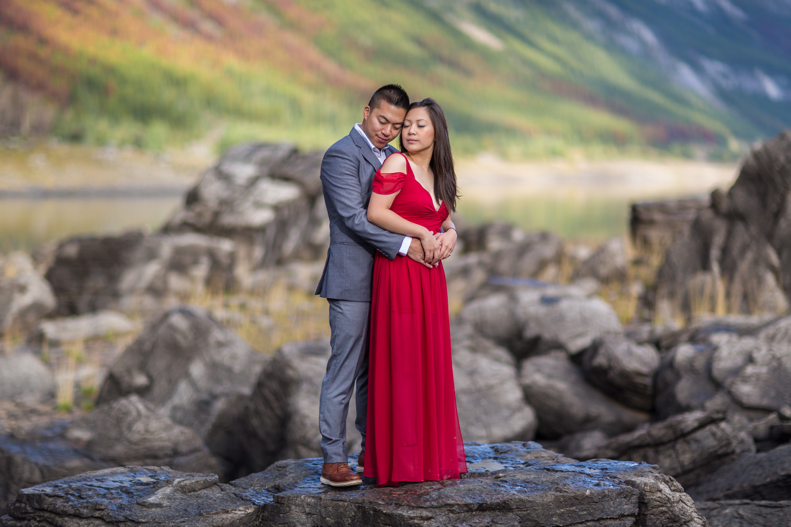 Jasper Engagement Pictures with Grey Suit and Red Dress