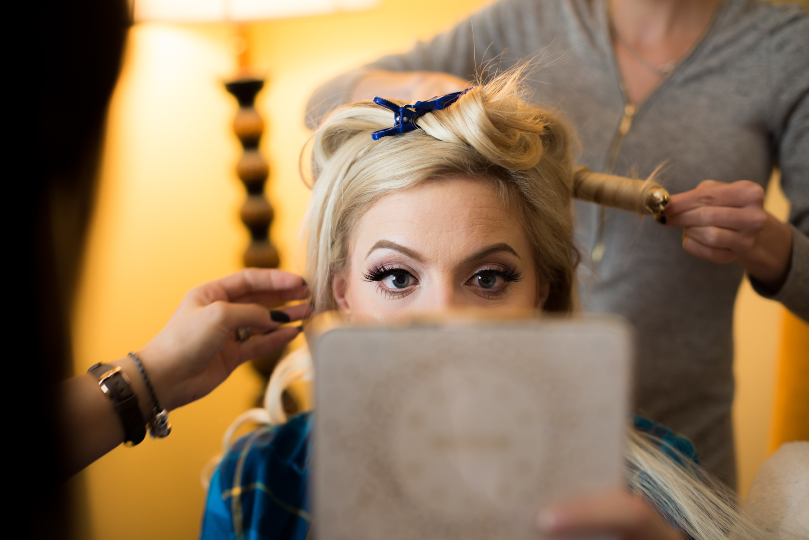 photo of bride getting hair and makeup done