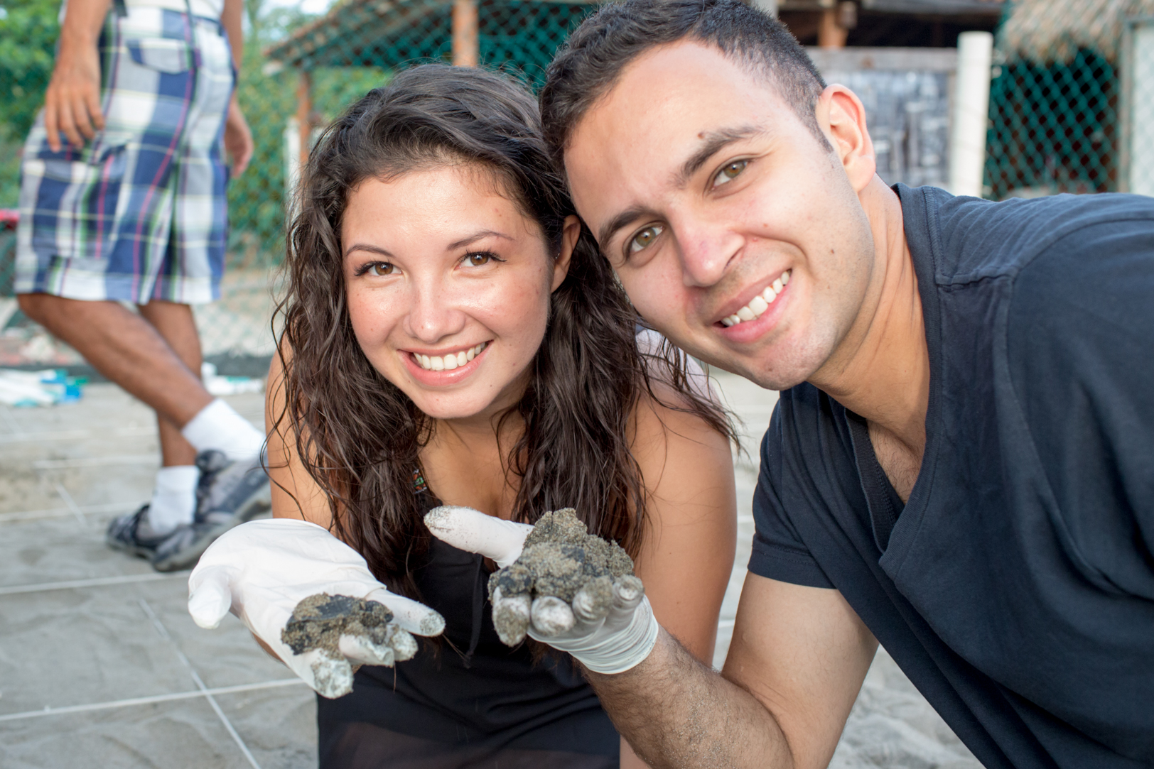 Couple holding turtles during their Ixtapa Destination Wedding