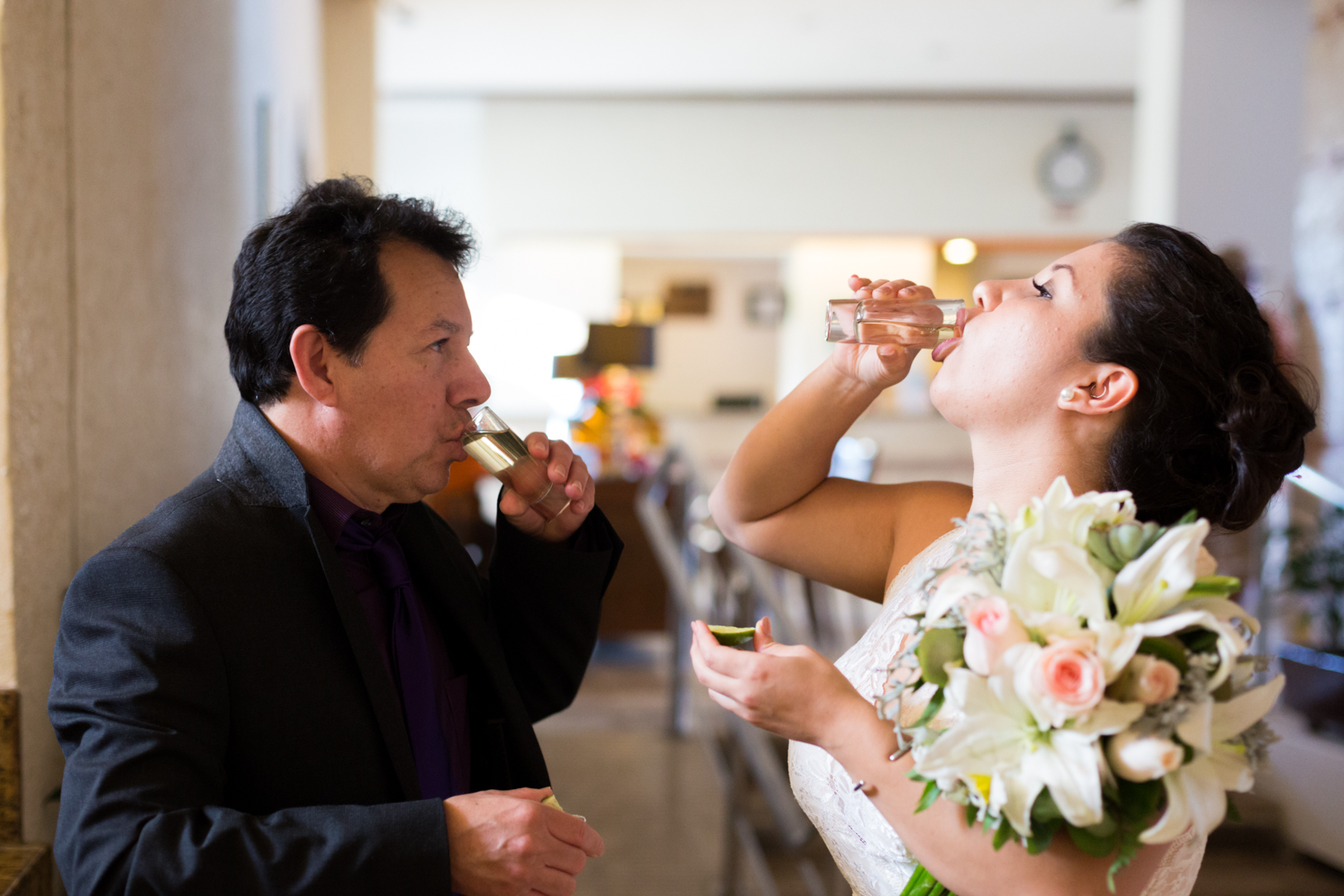 Bride doing a shot with dad before the ceremony