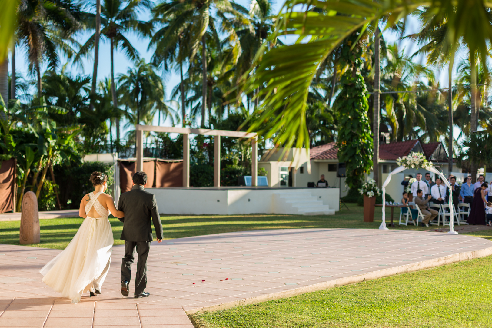 A picture of a father walking his daughter down the aisle at Sunscape Dorado Pacifico Ixtapa destination wedding