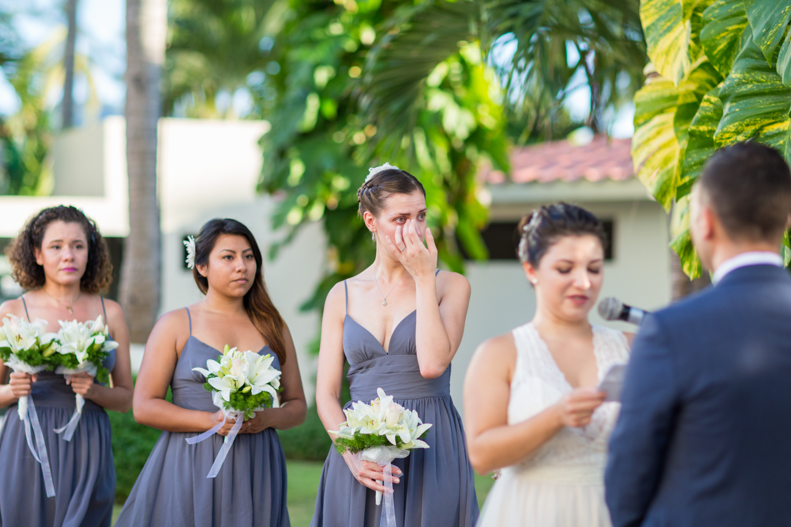 Bridesmaid crying during vows