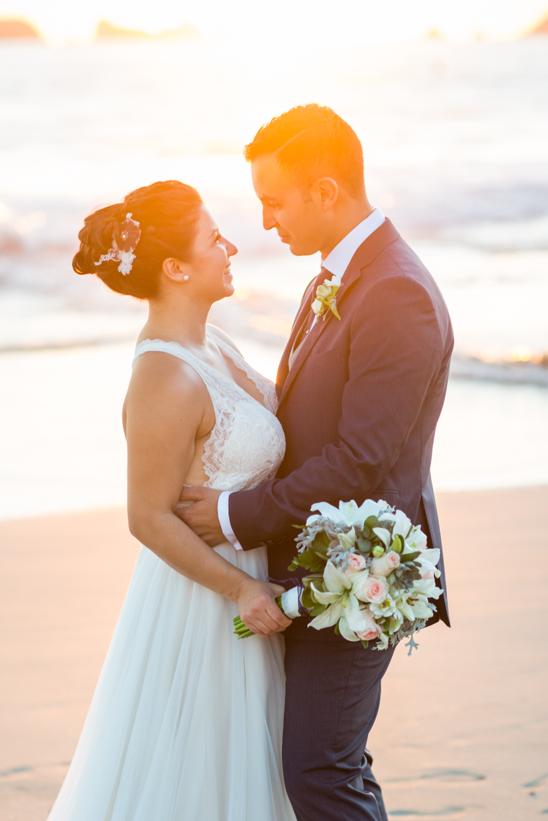 Bride and groom beach portrait at Sunscape Dorado Pacifico Ixtapa destination wedding