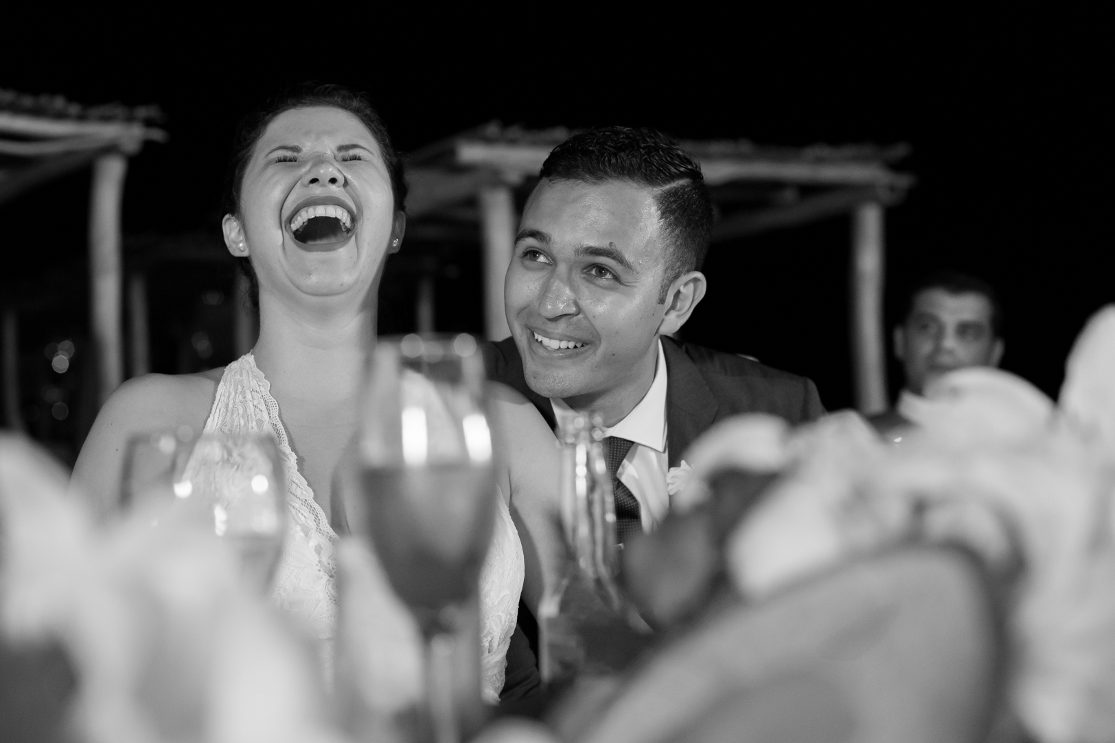 Bride laughing during speeches at Sunscape Dorado Pacifico Ixtapa destination wedding