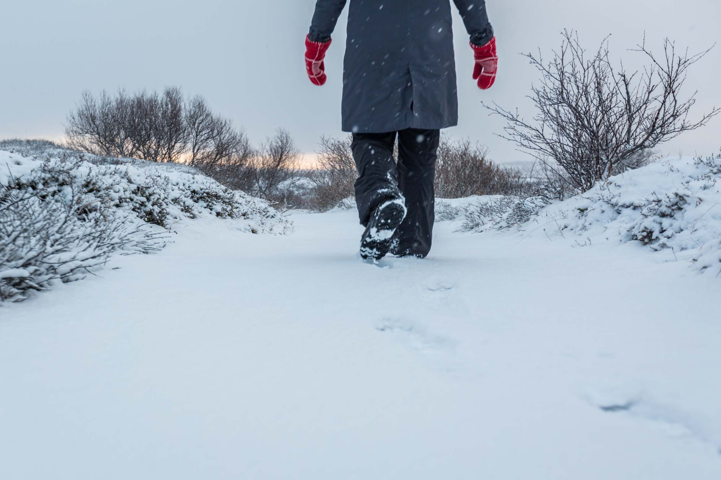 Picture Of Walking Through The Snow - What To Wear In Iceland During Winter
